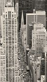 Urban city street aerial view in black and white. New York City Manhattan with skyscrapers, pedestrian and busy traffic. poster