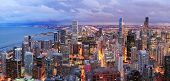 Chicago skyline panorama aerial view with skyscrapers over Lake Michigan with cloudy  sky at dusk. poster