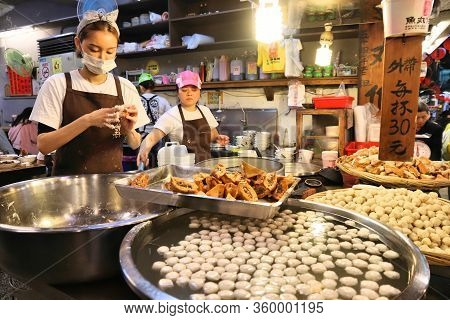 Jiufen, Taiwan - November 23, 2018: Cooks Prepare Traditional Food At Heritage Old Street Market Of