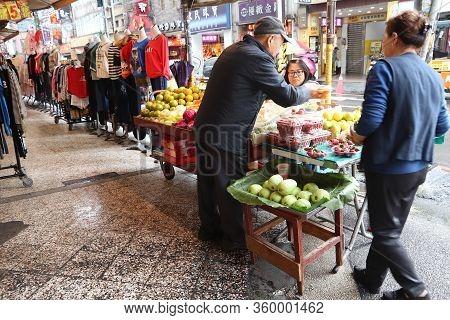 Keelung, Taiwan - November 23, 2018: Street Vendor Sells Fruit In Keelung, Taiwan. Markets Are Essen