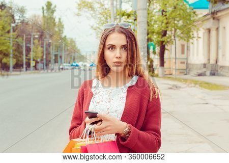 Shocked Woman With Phone Looking At You Camera Waiting For Her Bus At Bus Station Seeing An Accident