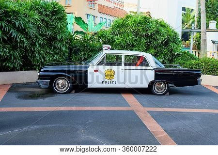 Retro Police Car Parked On Small Exhibition Zone In Sentosa Island. American Nostalgic Patrol Car. V