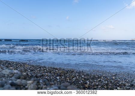 Waves On The Sea And Stone Beach