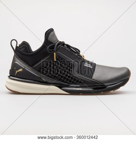 Vienna, Austria - August 14, 2017: Puma Ignite Limitless Leather Black And Gold Sneaker On White Bac