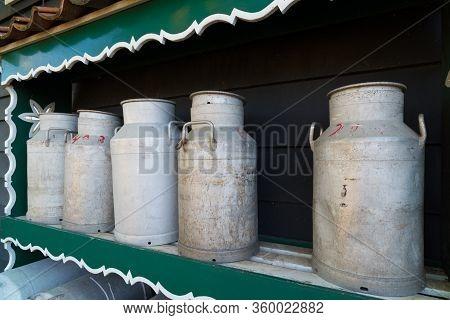 Zaanse Schans, Netherlands - October 13, 2018: Decorative Milk Cans In The Zaanse Schans, A Neighbor
