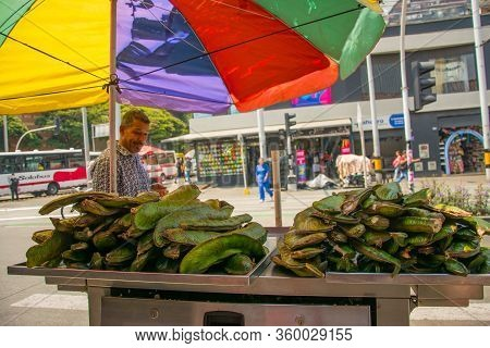 Medellin, Colombia - March 18, 2020: Informal Workers Selling Food In The Street During Quarantine