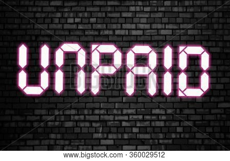 Unpaid Word Glowing Letters On Black Brick Wall. Financial Obligations Overdue Concept