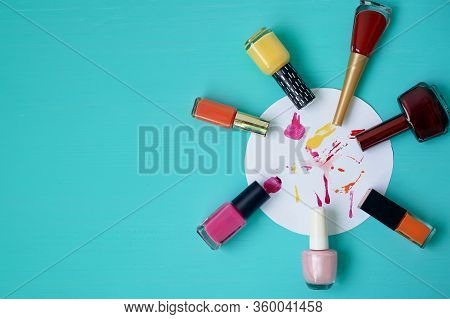 Colorful Varnishes On A Turquoise Background. On A Piece Of Paper Chaotic Drawing Of Varnishes. A Pa