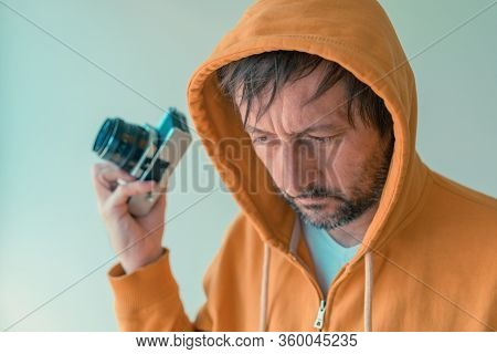 Photographer With Yellow Zip Hoodie Sweatshirt Holding Vintage Slr Camera, Selective Focus