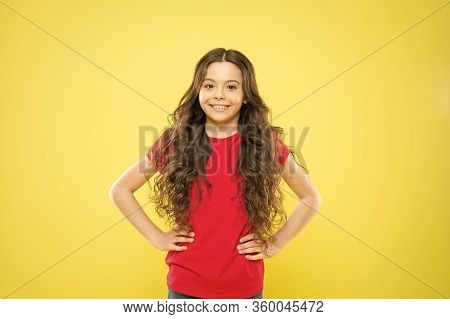 Wind Can Also Damage Hair. Girl Adorable Kid Long Wavy Hair Yellow Background. Strong Persistent Win