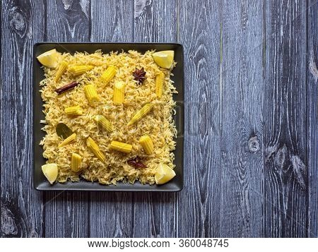Baby Corn Pulao On A Wooden Table. Vegetarian Biryani, Indian Food. Top View, Copy Space