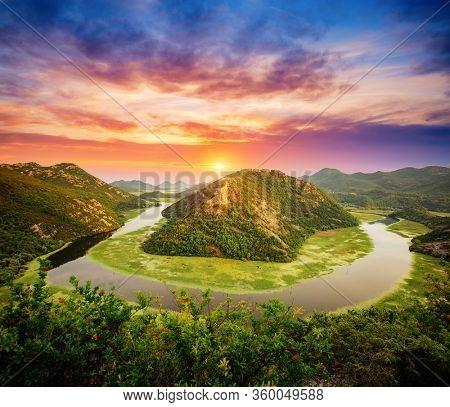 Splendid scene of winding river Rijeka Crnojevica flowing through mountains. Location National park Skadar Lake, Montenegro, Balkans, Europe. Exotic summer scene. Explore the beauty of earth.