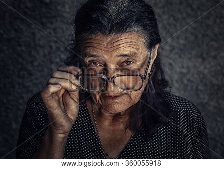 Closeup Portrait Of Skeptical Old Woman Looking Suspicious, Some Disgust  Disapproval On Face Isolat