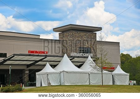 Medical Center With Tents Set Up Outside The Emergency Room Entrance To Screen People With Symptoms