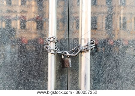 Lockdown Shop Market Closed Due To Coronavirus Pandemic Door Locked With Chain. Bankruptcy Of A Busi