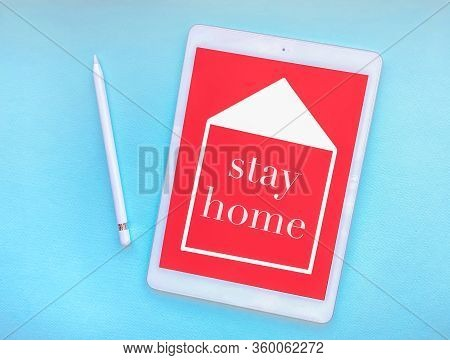 The Words Stay Home On The Tablet Screen, The Concept Of Quarantine At Home As A Preventive Measure