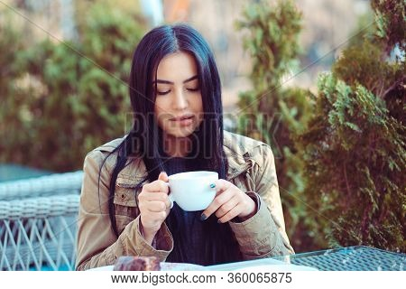 Woman Enjoying Her Looking At Craving For Her Cup Of Tea, Hot Beverage Eyes Closed On A Restaurant C