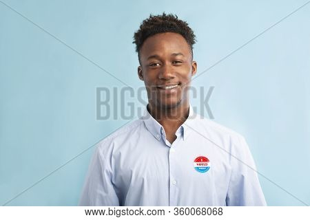 Happy African Patriotic Citizen Pinned Vote Button On T-shirt, Elections In America 2020, Blue Backg