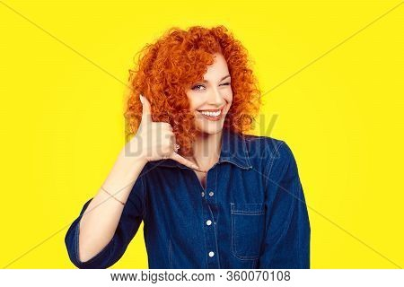Give Me A Call. Closeup Portrait Young Red Head Curly Single Woman Excited Happy Student Winking Wit