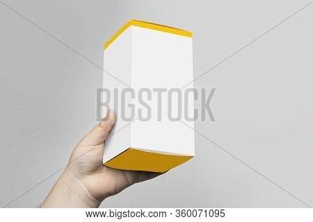 Little Child Hand Holding A Small Cubical Box, Mock Up Template Ready For Your Design