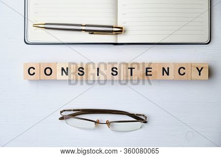 Modern Business Buzzword - Consistency. Top View On Wooden Table With Blocks. Top View. Close Up.