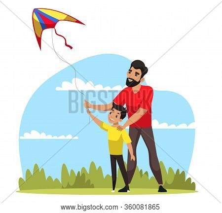 Daddy And Son Flying Kite And Having Fun Together In Park. Vacation Recreation, Weekend Playful Time