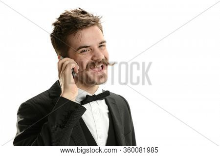 Young man wearing a bow tie on the cell phone having fun isolated on a white background