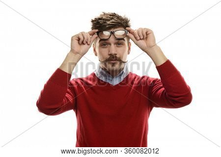 Young funny guy holding his glasses isolated on a white background