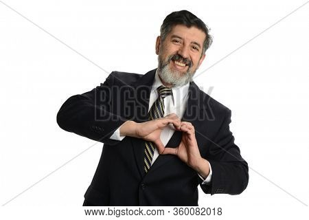 Mature businessman making a heart shape with his hands isolated on a white background