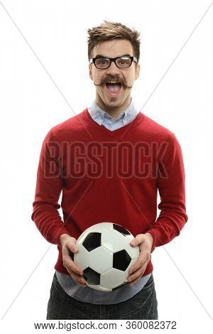 Young man holding a soccer ball expressing excitement isolted on a white background