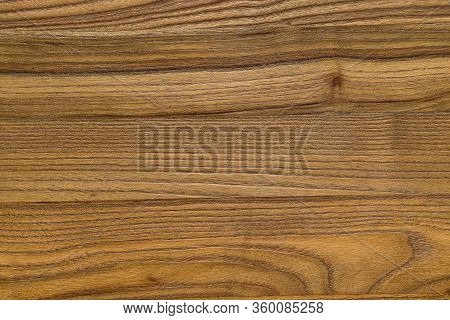 Closeup Of Wood Grain Fibers. The Wood Surface Is Colored With A Natural Medium Light Brown Stain An