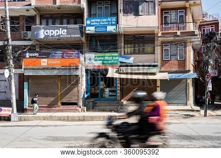 March 25, 2020. Kathmandu, Nepal. The Bouda Area. Against The Background Of An Empty Deserted Street