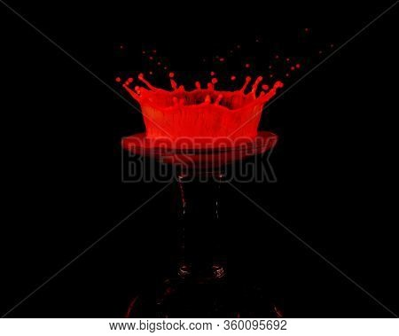 A Red Drop Of Milk Splashed Onto An Upturned Miniature Wine Glass Creates A Crown Shaped Splat Again