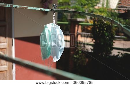 Wash And Dry Mask For Reuse To Protect Covid-19 Nearby The House And Hanging On Clothesline