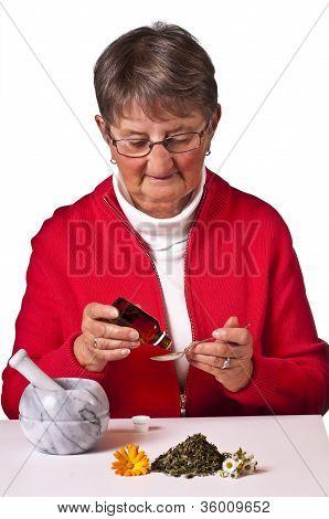 Pensioner Taking Herbal Drops