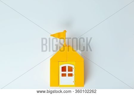 Lego House, Stay Home Stay Safe. Yellow Toy House With Lego Family. Self-isolation During Virus. Hom