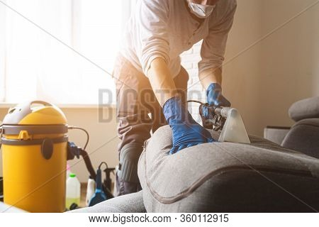 Man Cleaning Sofa Chemical Cleaning With Professionally Extraction Method. Upholstered Furniture. Ea
