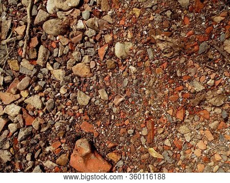 Red And White Granite Fine Gravel, Stone Background With Red Pebbles. Stone Texture. Top View Of Gro