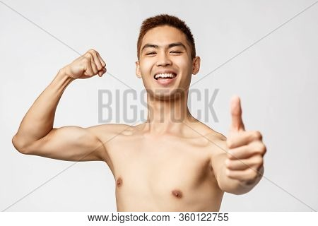 Workout, Lifestyle And Health Concept. Portrait Of Proud, Boastful Handsome Asian Man Flex Biceps, B