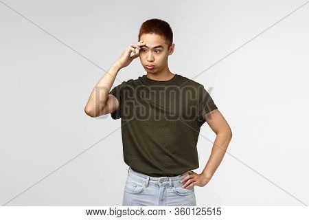 Annoyed And Distressed, Tensed Asian Guy Facepalm, Sighing Irritated, Look Away Trying Avoid Eye Con