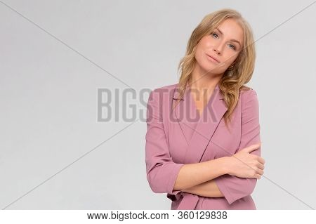 Portrait Of A Beautiful Young Woman Thinking, Isolated On Gray Background