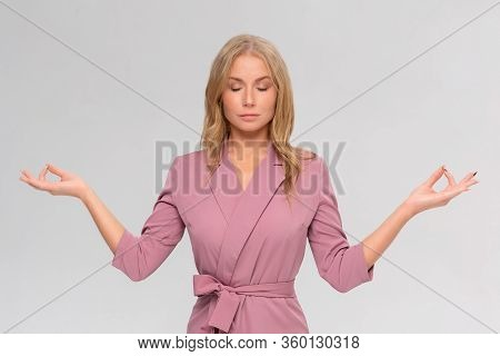 Patience Key To Success. Peaceful And Calm Pretty Blonde Female In Dress, Make Zen Gesture, Standing