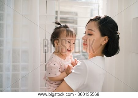 Single Mom And Daughter Portrait. Happy Family And People Concept. Mother And Children Day Theme.