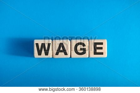 Wage Text On Wooden Blocks, Financial Business Concept, Blue Background