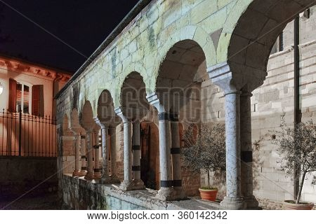 Night Photo Of The Cloister Of The Church Of San Giovanni In Valle In Verona, Italy. Detail Of The R
