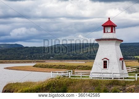 Anderson Hollow Lighthouse By The Shepody River Dam In Harvey, Bay Of Fundy, New Brunswick. Beautifu