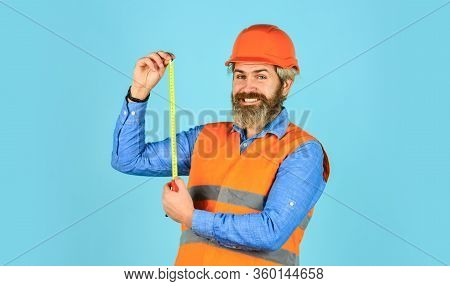 Custom Made Furniture. Worker Use Tape Measure. Size Concept. Hipster In Hard Hat. Make Measurements