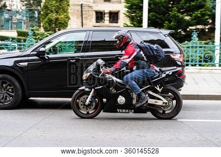 Commuters And Office Workers On Motorcycle During Rush Hour Traffic.  Traffic In Downtown Bucharest,