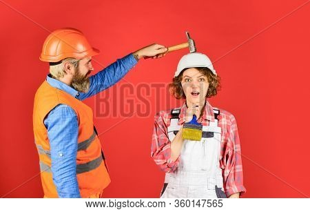 Intelligibly Concept. Couple Renovating Apartment Together. Man And Woman Wear Safety Helmet. Couple