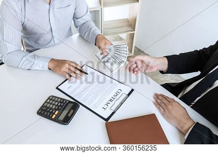 Illegal, Dishonest, Bribery And Corruption Concept, Businessman Giving Bribe Money In The Envelope O